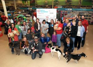 DMK dogs and volunteers receiving a Petco Grant in 2016!